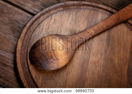 Wooden Spoon On Cutting Board Wood Texture