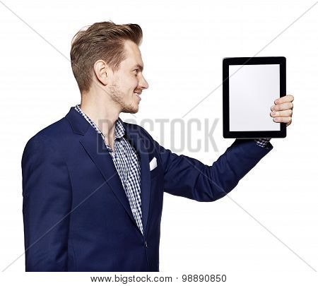 Young Man Is Looking At Digital Tablet