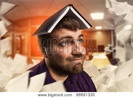 Man with notebook on his head
