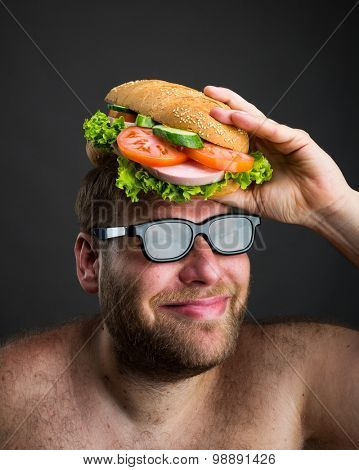 Man with sandwich on his head