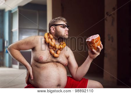 Fat man looks at big wurst