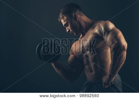 Muscle man doing bicep curls.