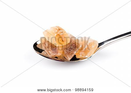 Brown Caramelized Sugar In A Wooden Spoon