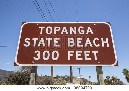 Topanga State Beach sign on Pacific Coast Highway in Malibu, California.