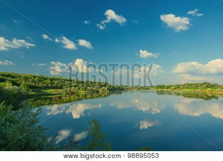 Calm beautiful rural landscape with a lake