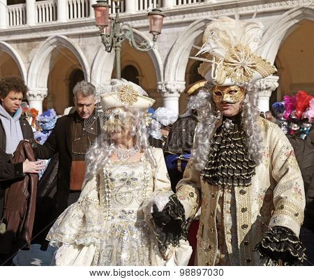 Masked Persons In Costume On San Marco Square, Venice, Italy.