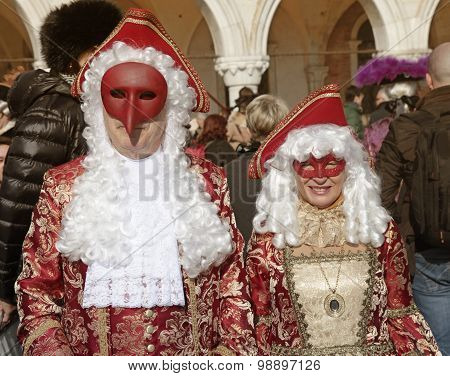 Masked Persons In Costume On San Marco Square, Carnival In Venice, Italy.