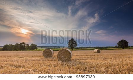 Stubble Field With Straw Bales