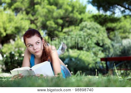 School Girl At The Park With The Book