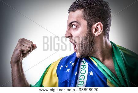 Man holding the Brazilian flag on white background