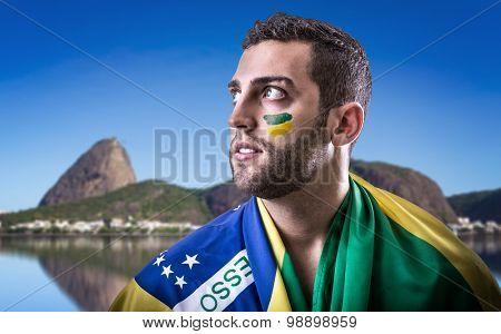 Brazilian fan holding the Brazilian flag in Rio de Janeiro
