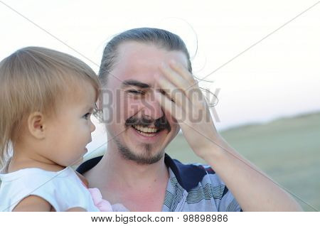 Daddy With Daughter Laughing