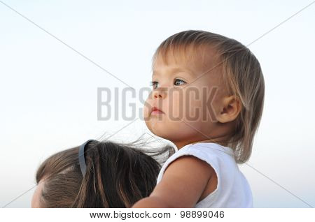 Baby Girl Portrait On Father's Neck