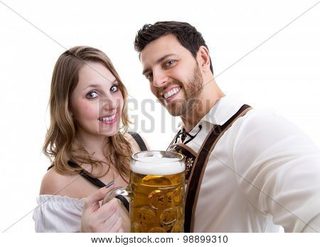 Couple in traditional bavarian costume on white background