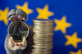 foto of bit coin  - Euro coin in mouth of hippo figurine EU flag - JPG