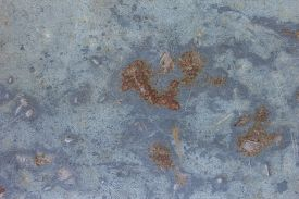 foto of rusty-spotted  - Old  metallic surface background with rusty spots - JPG