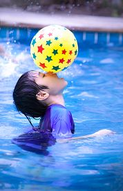 image of pool ball  - Asia kid at swimming pool - JPG