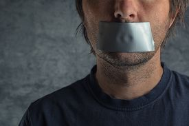 image of freedom speech  - Censorship adult caucasian man with duct tape on mouth to prevent him from speaking freedom of speech and expression concept - JPG