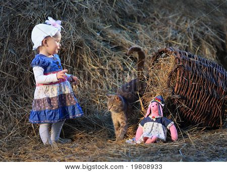 Little Girl And Cat In The Hayloft