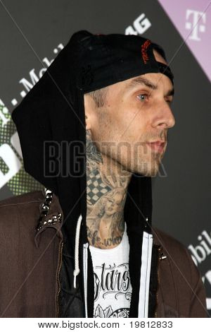 LOS ANGELES - APR 20:  Travis Barker arriving at the Launch Of The New T-Mobile Sidekick 4G  at Old Robinson/May Building on April 20, 2011 in Beverly Hills, CA.