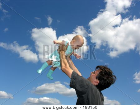Father With Baby In Sky