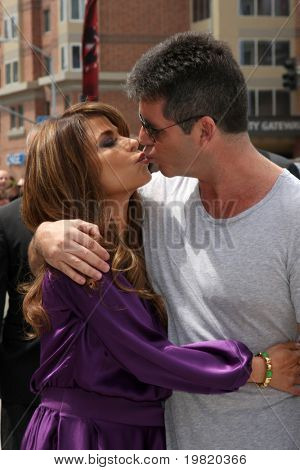 LOS ANGELES - MAY 8:  Paula Abdul & Simon Cowell, two of the talent judges arriving at the