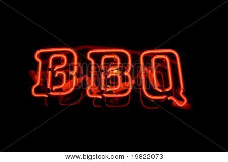 Red neon sign of the word 'BBQ' on a black background.