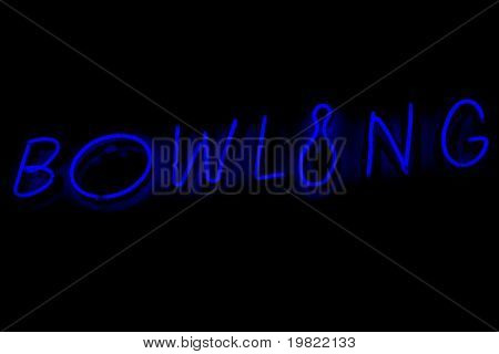 Blue neon sign of the word 'Bowling' on a black background.