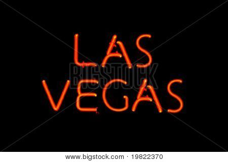 Red neon sign of the words 'Las Vegas' on a black background.