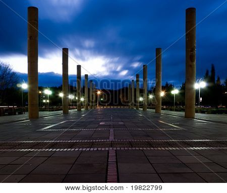 Long exposure of pillars with blueish clouds hovering by. Dusk.