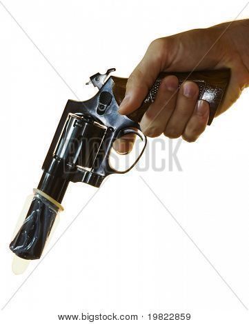 Cropped shot of a male hand holding a .38 calibre with a condom on it.