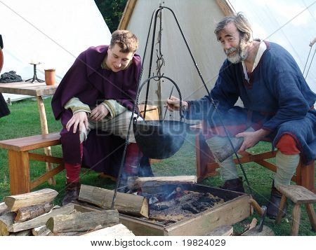 medieval men camping out and cooking