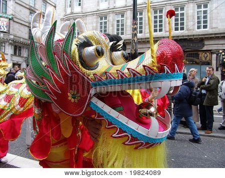 Chinese New Year dragon dancing in parade in London, England