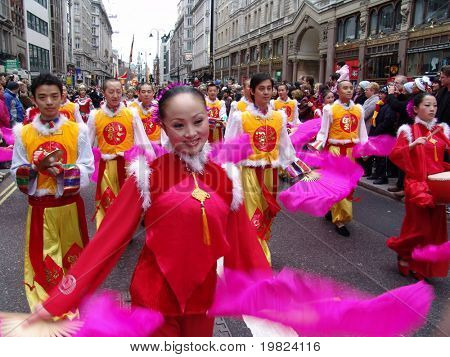 Fan dancers in the street in Chinese New Year Parade