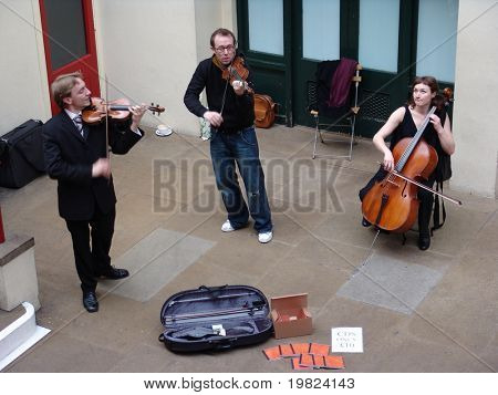 Musical trio performing at Covent Garden in London