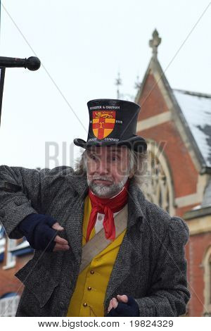 ROCHESTER CITY, KENT, ENGLAND - DEC 11: Unidentified English actor plays part of lamplighter on December 11, 2010 in Rochester City ,Kent, England at the annual Dickens Festival.