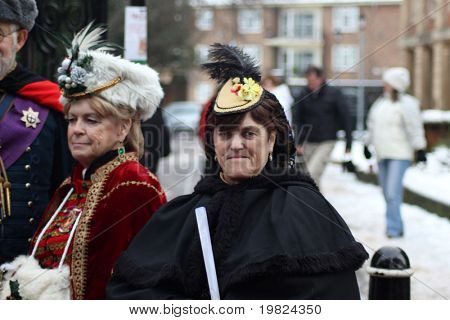 ROCHESTER CITY, KENT ,ENGLAND - DEC 11: Two elderly ladies dress in costumes from Dickens Festival in Rochester on December 11, 2010. The Dickens Festival is an annual event in Rochester.