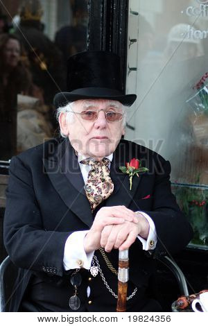 ROCHESTER CITY, KENT ,ENGLAND - DEC 11: Unidentified elderly gentleman in Dickensian costume and top hat at annual Dickens Festival in Rochester on December 11, 2010. The Dickens festival is a yearly event.
