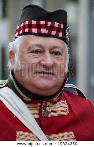 ROCHESTER CITY, KENT ,ENGLAND - DEC 11: Unidentified gentleman acts as Victorian Scottish soldier at Dickens Festival on December 11, 2010 in Rochester City, England