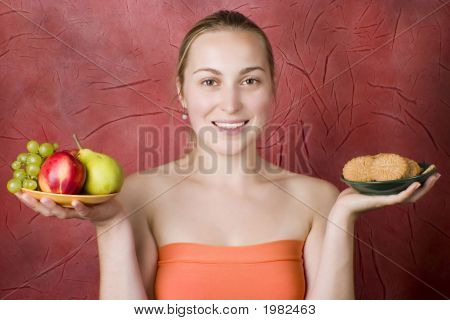 Smiling Girl With Fruits And Cookies