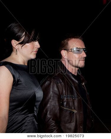 NEW YORK - APRIL 21: Musician Bono of U2 and guest attend the Vanity Fair party for the 2009 Tribeca Film Festival April 21, 2009 in New York.