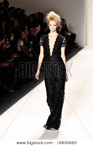 NEW YORK - FEBRUARY 11: A model walks the runway for the Ruffian collections Mercedes-Benz Fashion Week at Lincoln Centre on February 11, 2011 in New York.