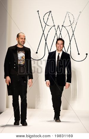 NEW YORK - FEBRUARY 11: Designers Brian Wolk and Claude Morais walks the runway for the Ruffian collections Mercedes-Benz Fashion Week at Lincoln Centre on February 11, 2011 in New York.