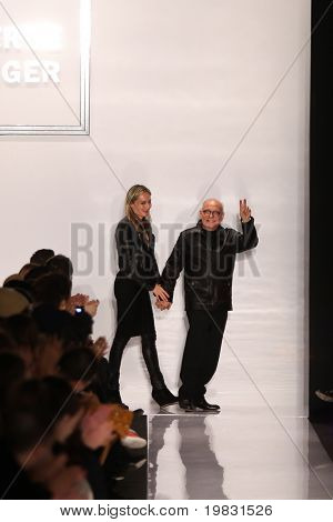 NEW YORK - FEBRUARY 15:   Max Azria with guest walks the runway for Herve Leger by Max Azria  collections Mercedes-Benz Fashion Week at Lincoln Centre on February 15, 2011 in New York.