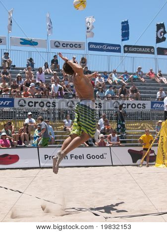 HUNTINGTON BEACH, CA. - MAY 23: Ty Loomis jump serve during the AVP Huntington Beach Open south of the pier on the weekend of the 22nd -24th in Huntington Beach, California May 23rd 2009