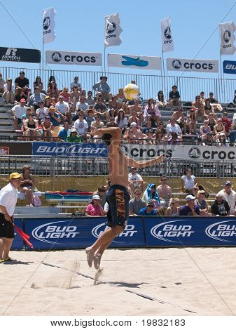 HUNTINGTON BEACH, CA. - MAY 23: Todd Rogers serve at the AVP Huntington Beach Open south of the pier on the weekend of the 22nd -24th in Huntington Beach, California May 23rd 2009