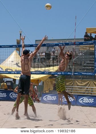 HUNTINGTON BEACH, CA. - MAY 23: Phil Dalhausser blocks Ty Loomis spike at the AVP Huntington Beach Open south of the pier on the weekend of the 22nd -24th in Huntington Beach, California May 23rd 2009