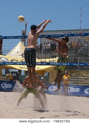 HUNTINGTON BEACH, CA. - MAY 23: Ty Loomis and Casey Patterson trying to get one past Phil Dalhausser at the AVP Huntington Beach Open on the weekend of the 22nd -24th in Huntington Beach, California May 23rd 2009