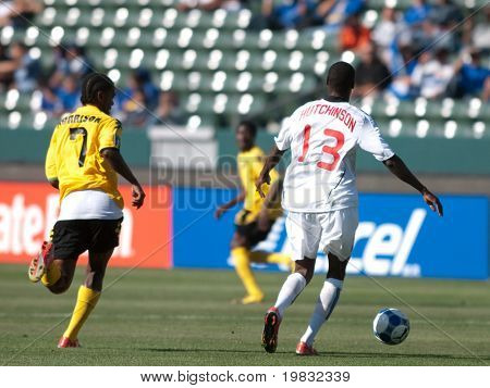 CARSON, CA. - JULY 3: Concacaf Gold Cup soccer match, Canada vs. Jamaica at the Home Depot center in Carson. Atiba Hutchinson and Jason Morrison making a move for the ball on July 3, 2009.
