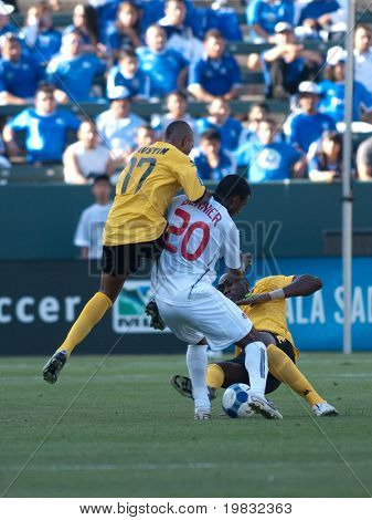 CARSON, CA. - JULY 3: Concacaf Gold Cup soccer match, Canada vs. Jamaica at the Home Depot center in Carson. Rodolph Austin, Patrice Bernier, and Claude Davis fight for the ball on July 3, 2009.